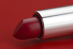 Batom vermelho no fundo vermelho Imagem de Stock Royalty Free