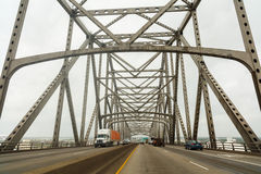Baton Rouge Bridge. Baton Rouge, Louisiana USA - March 31, 2016: Westbound travel on the Interstate highway 10 bridge over the Mississippi River on a cloudy day Stock Images