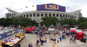 BATON ROUGE, LOUISIANA - 2014: Car painted in the gold and purple LSU colors during a football game. A volkswagen gold painted in the LSU colors is parked at a stock image