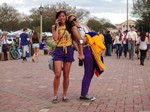 BATON ROUGE, LOUISIANA - 2014: Two fans hold hands and smile during an LSU game. Two fans hold hands and smile at Louisiana State University during an LSU stock photos