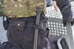 Baton and a shield of a policeman Stock Photos