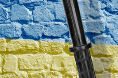 Baton and Ukrainian flag Stock Images