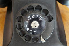 BatPhone. Old black disk phone, it still works! With numbers from 0 to 9, on the table Royalty Free Stock Photo