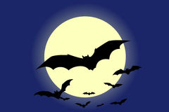 Bats. Flying bats with the moon in background Stock Images