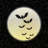 Bats against a disk of the moon Stock Photos