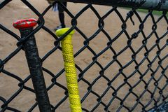 Baseball / softball bats on a batting fence stock images