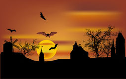Bats flying above castle at sunset Stock Image