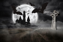 Bats flying from draculas castle Royalty Free Stock Image