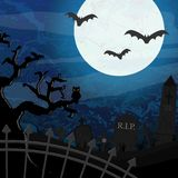 Halloween graveyard and bats in front of full moon Stock Images