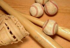 Bats Glove & Baseballs. 2 Bats, catchers mit & baseballs royalty free stock photos