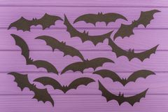 The bats halloween silhouettes cut out of paper. On purple wooden board. Halloween holiday Royalty Free Stock Photo