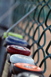 Baseball bat softball bats hanging on a fence Royalty Free Stock Photos
