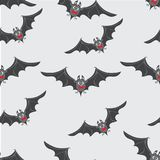 Bats with red bow ties. Happy Halloween. Stock Photo