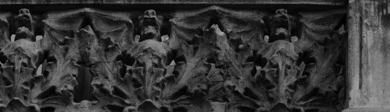Bats on the row. Shot in black and white. Placed on the facade of this historic building, sculpture representing a line of bats. Set in Eixample, Barcelona stock photo