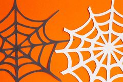 Web of paper on orange and black background stock images