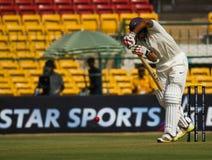 Batsman back foot. A batsman plays on the back foot royalty free stock photos