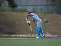 Batsman hitting cricket ball Royalty Free Stock Photos