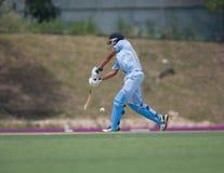 Batsman hitting cricket ball Royalty Free Stock Photography