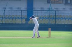 Batsman leaving a ball in a cricket match-India royalty free stock images
