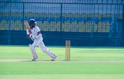 Batsman stance after playing shot in a cricket match-India stock photo