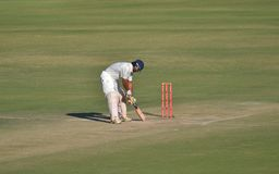 Batsman taking leg stump during a Cricket Match Stock Photos