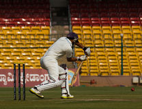 Batsman view from back. Cricketer Ganesh Satish bats during the ongoing Irani Cup game in Bengaluru. View from the slips angle Royalty Free Stock Photo