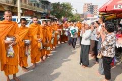 Monks during food gathering at Battambang on Cambodia Stock Photos