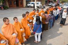 Monks during food gathering at Battambang on Cambodia Stock Photo