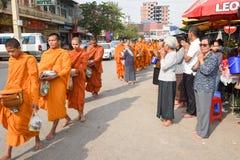 Monks during food gathering at Battambang on Cambodia Royalty Free Stock Image