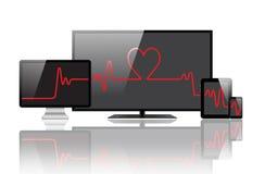 Battement de coeur sur les moniteurs Photos libres de droits