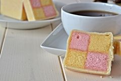 Battenberg cake with a cup of tea Royalty Free Stock Photography