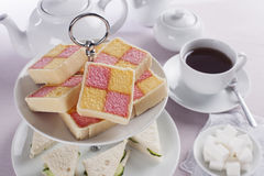 Battenberg Cakes and Tea Stock Photography