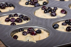 Batter and berries to make muffins Royalty Free Stock Photography