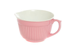 Batter Bowl. Pretty pink batter mixing bowl isolated on white background stock photo