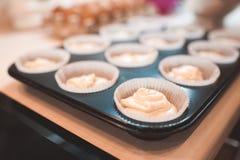 Batter for cupcakes. Raw dough for cupcake in baking tray  closeup. Selective focus Stock Photos