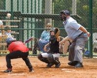 Batter Dodging a Ball in Little League Baseball Stock Image