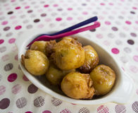 Batter fried banana ball. Topping with honey Royalty Free Stock Photography