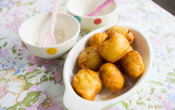 Batter fried banana ball topping with honey Royalty Free Stock Image