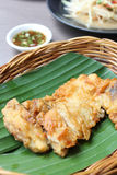 Batter-fried chicken Breat on a banana leaf. With sauce Royalty Free Stock Images