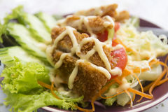Batter fried fish with salad Stock Photo