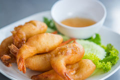 Batter fried prawns with plum sauce and vegetable, on a white pl Royalty Free Stock Image