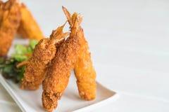 batter-fried prawns on wood Stock Images
