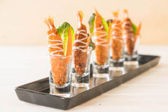 batter-fried prawns on wood Stock Photos
