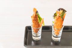 batter-fried prawns on wood Stock Photography