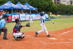 Batter hit the bal l and the ball slided away Royalty Free Stock Photos