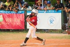 Batter hit the ball in a baseball game. ZHONGSHAN PANDA CUP, ZHONGSHAN, GUANGDONG - August 4:batter of team TaiWan Zhanghua Dongshan Primary School hit the ball Royalty Free Stock Images