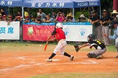 Batter hit the ball in a baseball game. ZHONGSHAN PANDA CUP, ZHONGSHAN, GUANGDONG - August 4:batter of team TaiWan Zhanghua Dongshan Primary School hit the ball Stock Image
