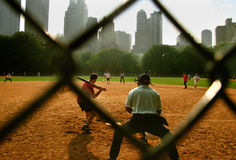 Batter Hitting Ball Stock Images