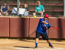 Batter Hitting a Softball - Special Olympics. Salem, VA – August 20th; A batter hitting a softball at the Special Olympics North America Softball Championship Stock Images