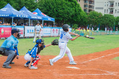 Batter just missed the ball in a baseball game. ZHONGSHAN PANDA CUP, ZHONGSHAN, GUANGDONG - July 23:batter of team BeiJing TianTan DongLi Primary School just Stock Photo